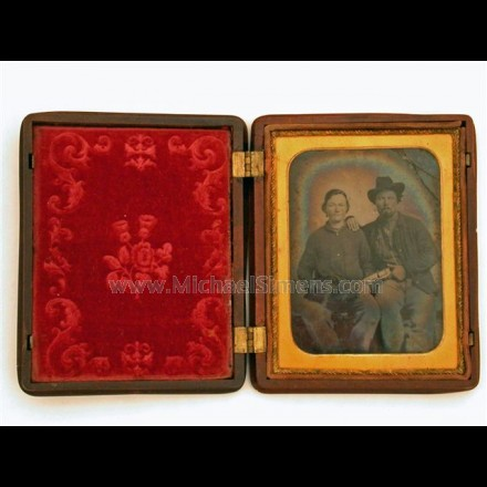 CIVIL WAR PHOTOGRAPH - AMBROTYPE WITH TWO SOLDIERS. ONE SOLDIER IS ARMED WITH A COLT DRAGOON AND THE OTHER UNDOUBTEDLY A WOMAN!